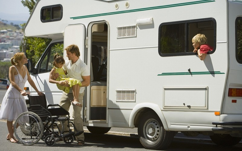 Family getting in RV with wheelchair