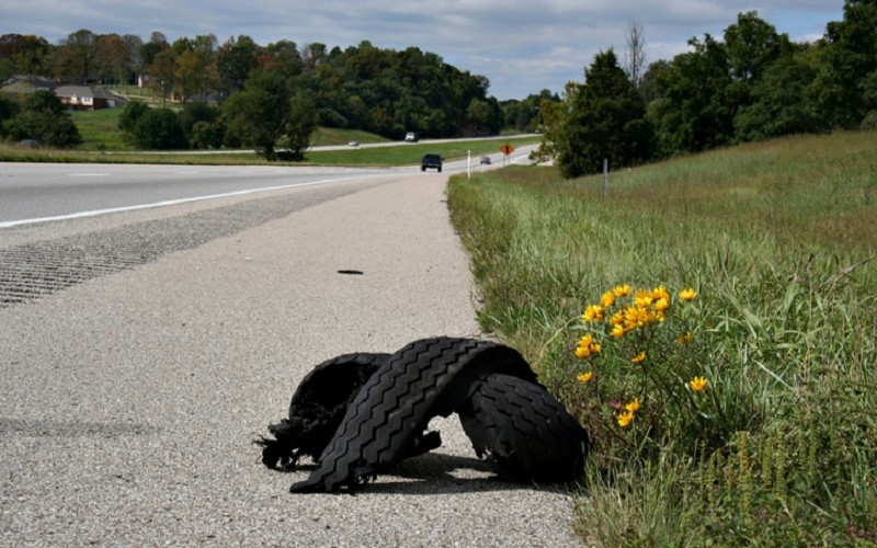 tire on the side of road