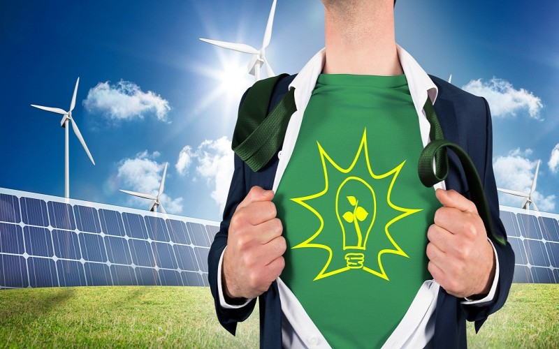 Businessman opening shirt with wind turbines and solar panels