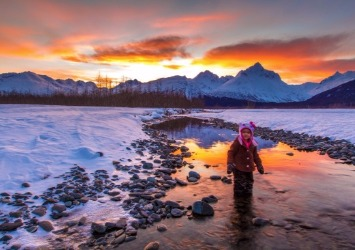 Toddler Poses In The Wild As The Sun Goes Down [Photo Credit: Alaska Photography]