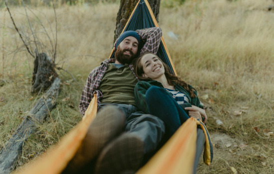Couple Relaxes In Their Trek Hammock [Courtesy/Trek Light Gear]